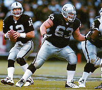 Oakland Raiders quarterback Rich Gannon drops back to pass, with center Barret Robins protecting, 2002. photo by Ron Riesterer