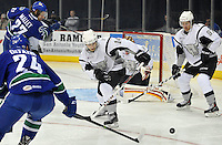 San Antonio Rampage center Vincent Trocheck, center, and Rampage defenseman Matt Gilroy, right, defend the net against Utica Comets left wing Brandon DeFazio (24) and Comets center Alex Mallet, during the first period of an AHL hockey game, Monday, Jan. 13, 2014, in San Antonio (Darren Abate/AHL)
