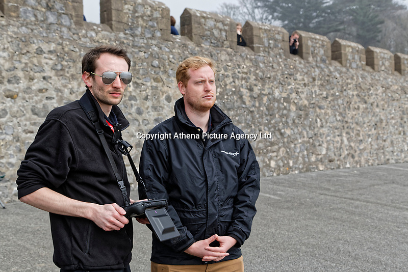 Pictured: Drone operator Jonathan Brewster (L). Friday 20 April 2018 <br /> Re: The Royal National Lifeboat Institution (RNLI) and the Maritime and Coastguard Agency (MCA) have held a special media event to demonstrate how drones could be used in search and rescue activity in the future to help save lives at the Atlantic College in St Donats, south Wales, UK. <br /> The rescue scenario took place along a stretch of coastline in south Wales, featuring a drone, an RNLI lifeboat and an MCA helicopter winching the casualty to safety.