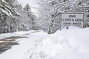 Bear Notch Road in the White Mountains, New Hampshire during the winter months. Bear Notch Road is a seasonal road closed and gated during the winter season.