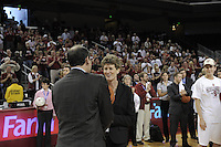 March 14, 2010.  Associate Head Coach Amy Tucker receives her game ball after the Stanford Cardinal beat the UCLA Bruins to win the 2010 Pac-10 Tournament.