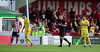 Fleetwood Town's Danny Andrew is shown a yellow card by referee Stephen Martin<br /> <br /> Photographer Chris Vaughan/CameraSport<br /> <br /> The EFL Sky Bet League One - Lincoln City v Fleetwood Town - Saturday 31st August 2019 - Sincil Bank - Lincoln<br /> <br /> World Copyright © 2019 CameraSport. All rights reserved. 43 Linden Ave. Countesthorpe. Leicester. England. LE8 5PG - Tel: +44 (0) 116 277 4147 - admin@camerasport.com - www.camerasport.com
