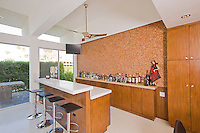 Sideview of elegant wetbar in a remodeled mid-century architecture home