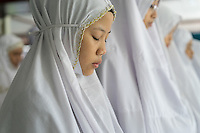 January 13, 2015 - Puchong, Kuala Lumpur (Malaysia). A young student prays at the Sekolah Menengah Islam Global Ikhwan school in Puchong, in the south of Kuala Lumpur. Young female daughters of Ikhwan members attend the school to study arabics, read the Koran and following practical classes to learn how to cook, clean or take care of babies. © Thomas Cristofoletti / Ruom