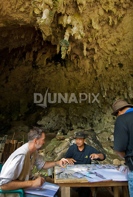 "Team leader Thomas Sutikna and stone tool expert Mark Moore discuss the Liang Bua .dig, discovery site of the Flores ""hobbit"", Homo floresiensis"