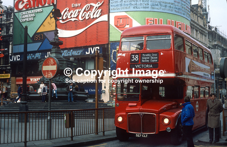 Picadilly Circus, London, UK, red bus drives past,  198101000038PC3..Copyright Image from Victor Patterson, 54 Dorchester Park, Belfast, United Kingdom, UK...For my Terms and Conditions of Use go to http://www.victorpatterson.com/Victor_Patterson/Terms_%26_Conditions.html