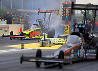 May 19, 2017; Topeka, KS, USA; NHRA top fuel driver Troy Coughlin Jr (far) does a burnout alongside Scott Palmer during qualifying for the Heartland Nationals at Heartland Park Topeka. Mandatory Credit: Mark J. Rebilas-USA TODAY Sports