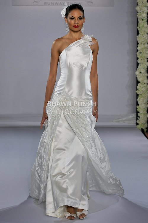 Model walks runway in a Clyde wedding dress from the Ruben Perlotti bridal collection, at the Couture Runway Show, during New York Bridal Fashion Week at The Hilton Hotel, October 13, 2012.
