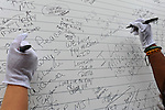 Fans sign their names and write messages in tribute at U.S. Steel Yard Stadium before a hometown tribute to Michael Jackson begins in Gary, Indiana on July 10, 2009. Jackson died on June 25 at a Los Angeles hospital.
