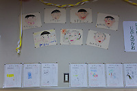 Self portrait drawings of the first year elementary school class in the classroom at. Kawauchi Elementary School, Kawauchi, Fukushima, Japan. Tuesday April 30th 2013. Kawauchi was evacuated after the accidents at Fukushima Daichi nuclear plant but has been nominally decontaminated and some of the school children have returned to classes though the first grade has only seven students..