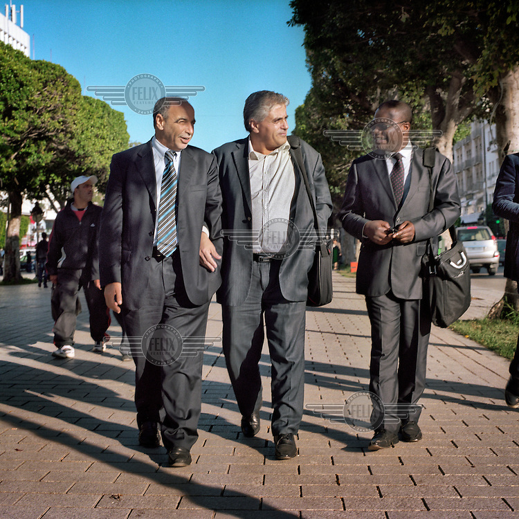 Three lawyers walking on Bourguiba Avenue. In the centre is Rajali Abdel Karim. The role of lawyers was essential in the Tunisian protests; by standing at the head of the rallies they gave legal legitimacy to the protests..
