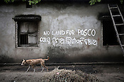 An anti Posco sign is seen on a house wall in village Dhinkia in Orissa, India. The local population of small villagers along the proposed Posco site have started a campaign and do not want to give away their land for the proposed Posco factory.