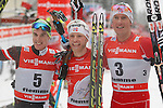 05/01/2014, Val Di Fiemme - 2014 Cross Country Ski World Cup Tour de ski <br /> Johannes Duerr (AUT) Norway's Martin Johnsrud Sundby and Chris Jespersen at the finish of the Final Climb pursuit race in Val Di Fiemme, Italy on 05/01/2014. Therese Johaug from Norway has won for the first time Tour de ski.