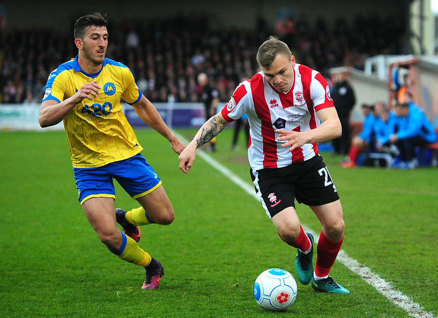 Lincoln City's Harry Anderson powers past Torquay United's Giancarlo Gallifuoco<br /> <br /> Photographer Andrew Vaughan/CameraSport<br /> <br /> Vanarama National League - Lincoln City v Torquay United - Friday 14th April 2016  - Sincil Bank - Lincoln<br /> <br /> World Copyright &copy; 2017 CameraSport. All rights reserved. 43 Linden Ave. Countesthorpe. Leicester. England. LE8 5PG - Tel: +44 (0) 116 277 4147 - admin@camerasport.com - www.camerasport.com