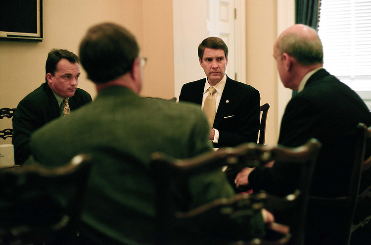 7/30/03.FRIST--Senate Majority Leader Bill Frist, R-Tenn., second from right, during a mid-morning meeting with aide Marty Gold, right, an expert on parliamentary procedure, and Dave Schiappa, left, secretary for the majority, and Eric Ueland, senior policy advisor, back to camera..CONGRESSIONAL QUARTERLY PHOTO BY SCOTT J. FERRELL