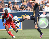 Sebastien Le Toux #9 of the Philadelphia Union pulls in a high ball as Nana Attakora #3 of Toronto FC moves in during an MLS match at PPL stadium in Chester, PA. on July 17 2010. Union won 2-1 with a last minute penalty kick goal.