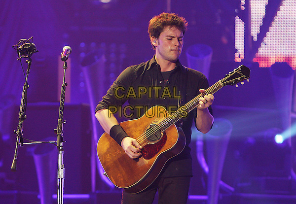 NICKELBACK  - Ryan Peake.Perform live in concert at Wembley Arena, London, England, UK,.19th January 2010..music gig band tour on stage playing performing guitar group half length  black shirt .CAP/MAR.© Martin Harris/Capital Pictures.