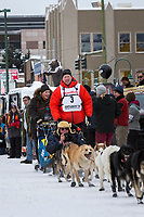 Mats Pettersson and team leave the ceremonial start line with an Iditarider and handler at 4th Avenue and D street in downtown Anchorage, Alaska on Saturday March 3rd during the 2018 Iditarod race. Photo ©2018 by Brendan Smith/SchultzPhoto.com