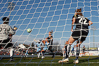 Sarah Walsh (8) of Sky Blue FC takes a shot while defended by Allison Falk (3) of the Los Angeles Sol. The Los Angeles Sol defeated Sky Blue FC 2-0 during a Women's Professional Soccer match at TD Bank Ballpark in Bridgewater, NJ, on April 5, 2009. Photo by Howard C. Smith/isiphotos.com