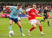 Accrington Stanley's Callum Johnson shields the ball from Fleetwood Town's Ashley Hunter<br /> <br /> Photographer Alex Dodd/CameraSport<br /> <br /> The EFL Sky Bet League One - Fleetwood Town v Accrington Stanley - Saturday 15th September 2018  - Highbury Stadium - Fleetwood<br /> <br /> World Copyright &copy; 2018 CameraSport. All rights reserved. 43 Linden Ave. Countesthorpe. Leicester. England. LE8 5PG - Tel: +44 (0) 116 277 4147 - admin@camerasport.com - www.camerasport.com