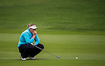 Ashlee Dewhurst of Australia lines up a putt during the Hyundai China Ladies Open 2014 on December 12 2014 at Mission Hills Shenzhen, in Shenzhen, China. Photo by Li Man Yuen / Power Sport Images