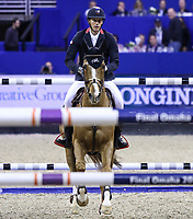 OMAHA, NEBRASKA - MAR 31: Kevin Staut rides Reveur de Hurtebise H D C during the FEI World Cup Jumping Final II at the CenturyLink Center on March 31, 2017 in Omaha, Nebraska. (Photo by Taylor Pence/Eclipse Sportswire/Getty Images)