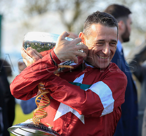 14h April 2018, Aintree Racecourse, Liverpool, England; The 2018 Grand National horse racing festival sponsored by Randox Health, day 3; Davy Russell lifts the trophy to celebrate winning the Grand National on Tiger Roll