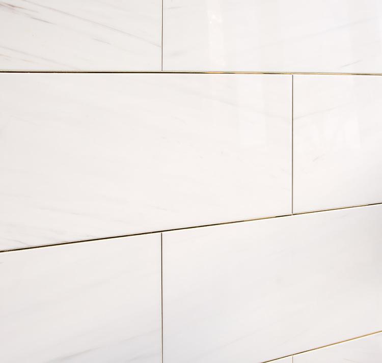 "12"" X 24"" bricks shown in polished Dolomite bricks with brass liners."