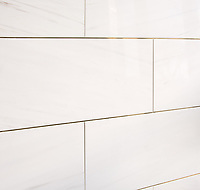 "12"" X 24"" bricks shown in polished Dolomite bricks with brass liners."