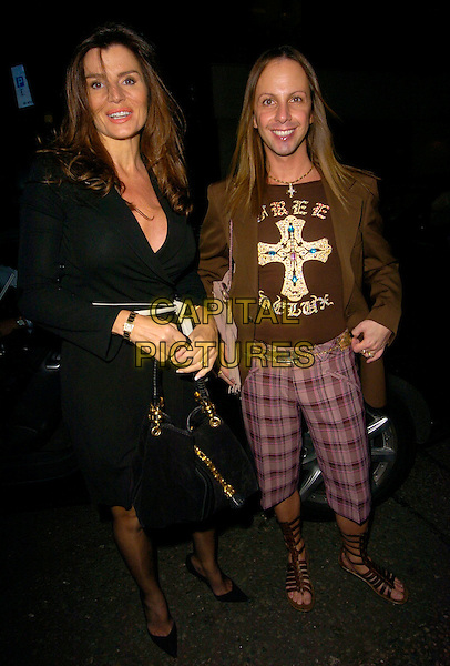 SUSIE VERRICO (BIG BROTHER) & RICARDO.The Indian Infusion VIP Launch Party, Pangaea nightclub, London, UK..October 12th, 2006.Ref: CAN.full length black dress purse bag purple plaid trousers brown jacket sandals.www.capitalpictures.com.sales@capitalpictures.com.©Can Nguyen/Capital Pictures