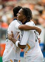 LA Galaxy defender Ante Jazic (4) congratulates teammate Carlos Pavon (20) on his 46th minute goal. The LA Galaxy defeated the Houston Dynamo 2-1  in a regular season MLS match at Robertson Stadium in Houston, TX on October 7, 2007.