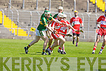 Kerry's Daniel Collins and Derry's Chris Convery in action in the Christy Ring Cup on Saturday.