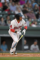 Catcher Isaias Lucena (19) of the Greenville Drive bats in a game against the Rome Braves on Thursday, April 12, 2018, at Fluor Field at the West End in Greenville, South Carolina. Greenville won, 14-4. (Tom Priddy/Four Seam Images)