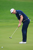 Stephen Gallacher (SCO) putts on the 1st green during Thursday's Round 1 of the 2014 BMW Masters held at Lake Malaren, Shanghai, China 30th October 2014.<br /> Picture: Eoin Clarke www.golffile.ie