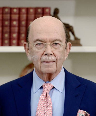 United States Secretary of Commerce Wilbur Ross looks on before U.S. President Donald Trump signs Executive Orders regarding trade in the Oval Office of the White House March 31, 2017 in Washington, DC. <br /> Credit: Olivier Douliery / Pool via CNP /MediaPunch