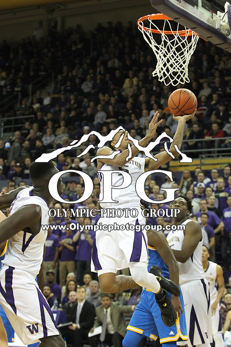JAN 1, 2016:  Washington's #5 Dejounte Murray drives to the basket against UCLA.  Washington defeated #25 ranked UCLA 96-93 in double overtime at Alaska Airlines Arena in Seattle, WA.