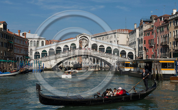 Venice-Italy - March 28, 2010 -- Traffic on Grand Canal / Canal Grande (not: Canale Grande) with gondolas, motor boats and quay for public water busses,  Rialto Bridge in the back -- infrastructure, transport, water, tourism -- Photo: Horst Wagner / eup-images