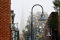 Fog covers the spire of the First United Methodist Church as seen thru the Downtown Mall in Charlottesville, VA. Photo/Andrew Shurtleff