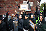 © Joel Goodman - 07973 332324 - all rights reserved . 11/11/2010 . London , UK . Siddhartha Dhar (1st right of centre) . Muslims Against Crusades hold a demonstration and burn a poppy on the anniversary of Armistice Day , at Kensington Gore , opposed by a demonstration of nationalist groups including the English Defence League ( EDL ) . Photo credit : Joel Goodman
