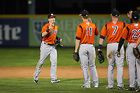 Bowie Baysox right fielder Mike Yastrzemski (18) high fives teammates including Drew Dosch (11) and Joey Terdoslavich (7) after a game against the Erie SeaWolves on May 12, 2016 at Jerry Uht Park in Erie, Pennsylvania.  Bowie defeated Erie 6-5.  (Mike Janes/Four Seam Images)