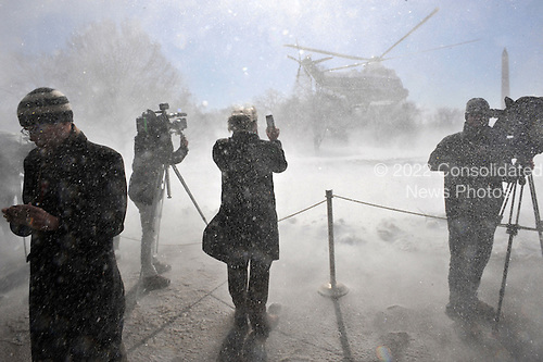 Marine One, with United States President Barack Obama aboard, blows snow at the press as it departs from the White House March 6, 2015 in Washington, DC. President Obama is traveling to Columbia, South Carolina for a town hall at Benedict College.<br /> Credit: Olivier Douliery / Pool via CNP