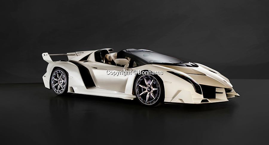 BNPS.co.uk (01202 558833)<br /> Pic: Bonhams/BNPS<br /> <br /> Sold for £6.76 million - Lamborghini Veneno.<br /> <br /> Super-rare Lambo leads incredible sell off an African vice presidents seized car collection.<br /> <br /> The State of Geneva impounded the 24 motors over a financial irregularity court case in 2016 and Bonhams sold off the sparkling collection for a whopping £20 million this weekend.<br /> <br /> An ultra-rare Lamborghini supercar has sold at auction for a world-record price of £6,760,000.<br /> <br /> The Veneno Roadster was one of only nine examples to be built in 2014 and was owned from new by the vice president of Equatorial Guinea.<br /> <br /> Teodorin Obiang Nguema kept the motor for two years before it was seized by Swiss authorities as part of a financial wrongdoing case.