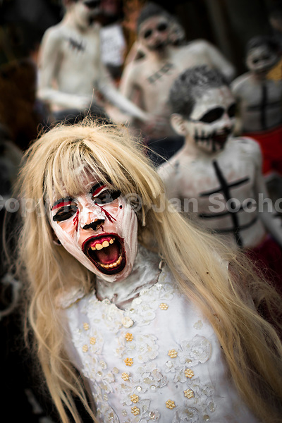 A Salvadoran boy, with blood face paint, performs an indigenous mythology character called La Llorona in the La Calabiuza parade at the Day of the Dead celebration in Tonacatepeque, El Salvador, 1 November 2016. The festival, known as La Calabiuza since the 90s of the last century, joins Salvador's pre-Hispanic heritage and the mythological figures (La Sihuanaba, El Cipitío, La Llorona etc.) collected from the whole Central American region, together with the catholic All Saints Day holiday and its tradition of honoring the dead relatives. Children and youths only, dressed up in scary costumes and carrying painted carts, march from the local cemetery to the downtown plaza where the party culminates with music, dance, drinking and eating pumpkin (Ayote) with honey.