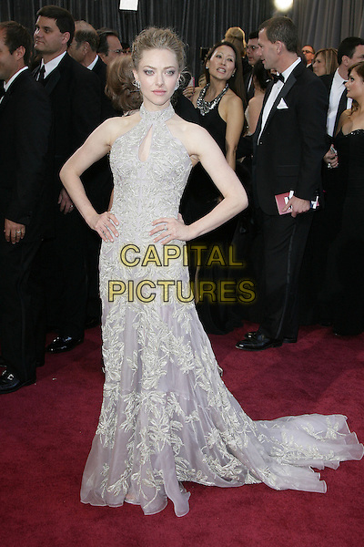 Amanda Seyfried (wearing Alexander McQueen).85th Annual Academy Awards held at the Dolby Theatre at Hollywood & Highland Center, Hollywood, California, USA..February 24th, 2013.oscars full length dress hands on hips embellished high collar keyhole bust cut out lilac purple sheer gold embroidered print sleeveless .CAP/ADM.©AdMedia/Capital Pictures.