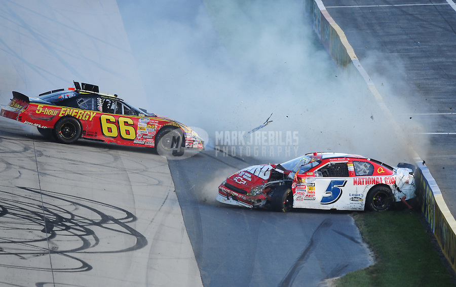 Sept. 20, 2008; Dover, DE, USA; Nascar Nationwide Series driver Landon Cassill (5) and Steve Wallace (66) crash during the Camping World RV 200 at Dover International Speedway. Mandatory Credit: Mark J. Rebilas-
