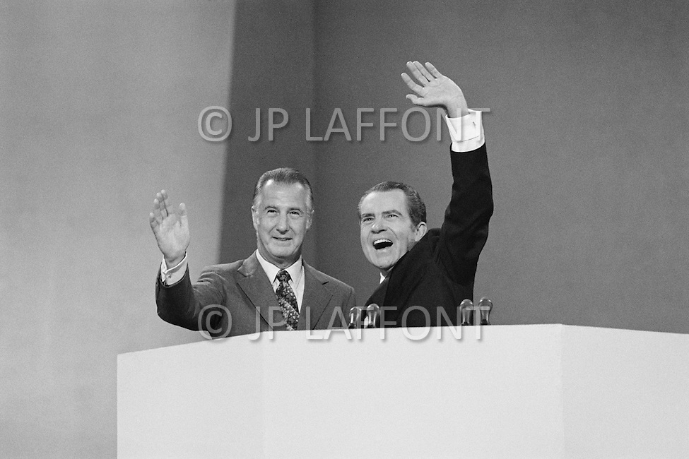 August 23rd 1972, Miami, Florida, USA. President Richard Nixon (R) shows his joy at being nominated as Republican presidential candidate with running-mate Spiro Agnew. He will campaign for re-election against the South Dakota Democrat Senator George S. McGovern. Outside of the 1972 30th Republican Convention, supporting former President Richard Nixon's re-election campaign, several thousand Women's Lib protesters demonstrate. The protest led by Jane Fonda, having just returned from her North Vietnam tour, was joined by the Vietnam Veterans to speak out against the war. The horror of the Vietnam war is interpreted in the street by young demonstrators. Police arrested 1000 demonstrators attempting to disrupt the convention.