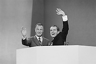 23 Aug 1972, Miami, Florida, USA --- President Richard Nixon (R) shows his joy at being nominated as Republican presidential candidate with running-mate Spiro Agnew. He will campaign for re-election against the South Dakota Democrat Senator George S. McGovern. Outside of the 1972 30th Republican Convention, supporting former President Richard Nixon's re-election campaign, several thousand Women's Lib protesters demonstrate. The protest led by Jane Fonda, having just returned from her North Vietnam tour, was joined by the Vietnam Veterans to speak out against the war. The horror of the Vietnam war is interpreted in the street by young demonstrators. Police arrested 1000 demonstrators attempting to disrupt the convention. --- Image by © JP Laffont   /Sygma/Corbis