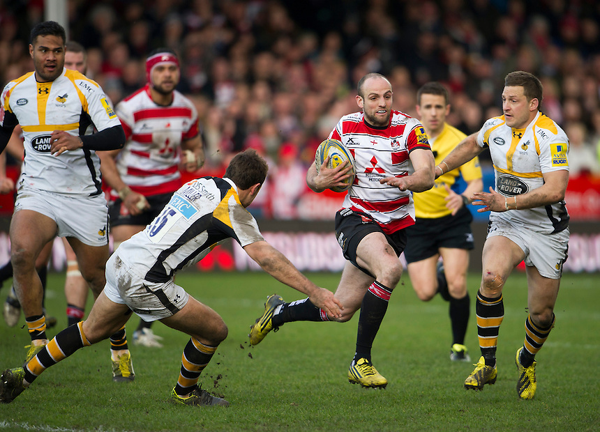 Gloucester Rugby's Charlie Sharples evades the tackle of Wasps' Rob Miller and Jimmy Gopperth<br /> <br /> Photographer Ashley Western/CameraSport<br /> <br /> Rugby Union - Aviva Premiership Round 15 - Gloucester Rugby v Wasps - Saturday 5th March 2016 - Kingsholm Stadium - Gloucester<br /> <br /> &copy; CameraSport - 43 Linden Ave. Countesthorpe. Leicester. England. LE8 5PG - Tel: +44 (0) 116 277 4147 - admin@camerasport.com - www.camerasport.com