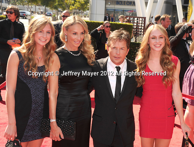 LOS ANGELES, CA - SEPTEMBER 15: Michael J. Fox, Tracy Pollan and family arrive at the 2012 Primetime Creative Arts Emmy Awards at Nokia Theatre L.A. Live on September 15, 2012 in Los Angeles, California.