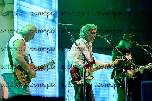 NEIL YOUNG & CRAZY HORSE - L-R: Frank 'Poncho' Sampedo, Billy Talbot, Neil Young - performing live at the O2 Arena in London UK - 17 Jun 2013.  Photo credit: George Chin/IconicPix